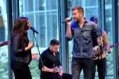 Hillary Scott and Charles Kelley of Lady Antebellum perform onstage during the 2014 CMT Upfront on April 2 2014 in New York City