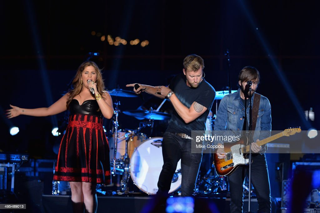 Hillary Scott, <a gi-track='captionPersonalityLinkClicked' href=/galleries/search?phrase=Charles+Kelley&family=editorial&specificpeople=3935435 ng-click='$event.stopPropagation()'>Charles Kelley</a> and <a gi-track='captionPersonalityLinkClicked' href=/galleries/search?phrase=Dave+Haywood&family=editorial&specificpeople=4620526 ng-click='$event.stopPropagation()'>Dave Haywood</a> of Lady Antebellum perform onstage at the 2014 CMT Music Awards Rehearsals Day 2 at Bridgestone Arena on June 3, 2014 in Nashville, Tennessee.