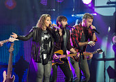 Hillary Scott Dave Haywood and Charles Kelley of the band Lady Antebellum perform on 'Jimmy Kimmel Live' on October 22 2014 in Los Angeles California