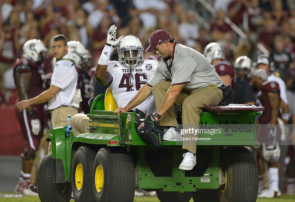 A.J. Hilliard #46 of the Texas A&M Aggies waves to the fans as he leaves the field with a leg injury during a game against the South Carolina Gamecocks at Williams-Brice Stadium on August 28, 2014 in Columbia, South Carolina. Texas A&M won 52-28.