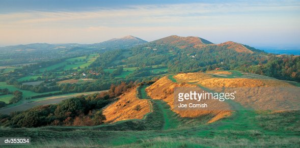 Hills and countryside in evening : Stock Photo