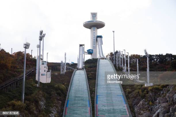 Hills stand at the Alpensia Ski Jumping Stadium the venue for ski jumping events at the 2018 PyeongChang Winter Olympic Games in Pyeongchang Gangwon...