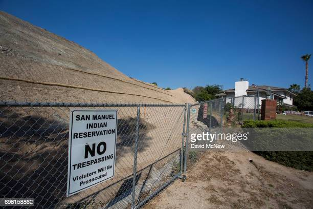 A hillside construction site at the edge of the San Miguel Indian reservation borders a neighborhood through which runs the San Andreas Fault on June...