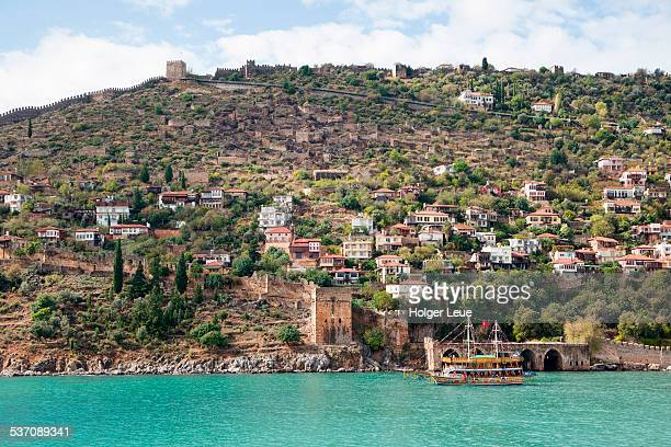 Hillside houses and Alanya Castle from sea