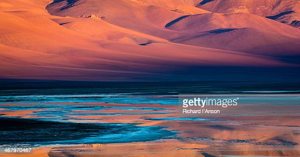 Hillside reflected in lagoon, Atacama Desert
