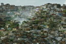 Hillside slums are shown May 21 2003 in Caracas Venezuela The Central Bank reported May 23 2003 Venezuela's economy is down 29 percent in the first...
