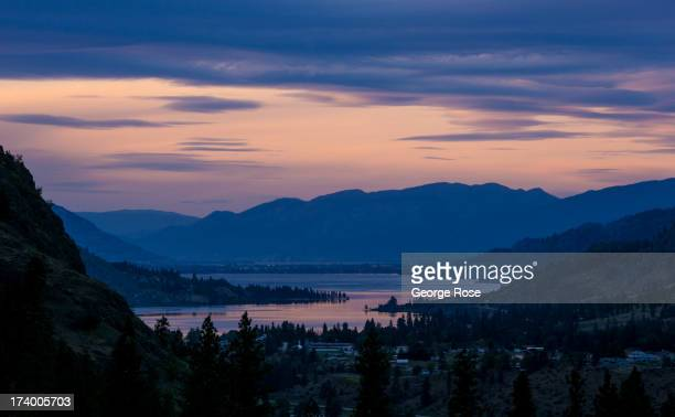 Hillside vineyards at the See Ya Later Ranch are viewed after sunset on June 9 2013 near Okanagan Falls British Columbia Canada Located across the US...
