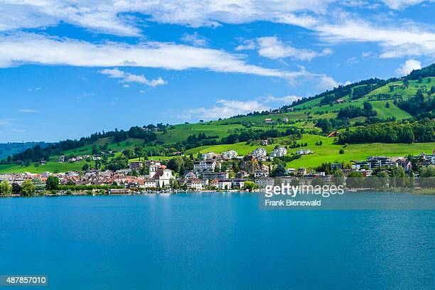 OBERAEGERI ZUG SWITZERLAND Hilly landscape with the Aegerisee a village mountains and green meadows