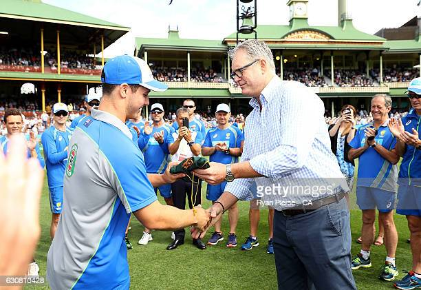 Hilton Cartwright of Australia recieves his Baggy Green Cap from Tom Moody during day one of the Third Test match between Australia and Pakistan at...