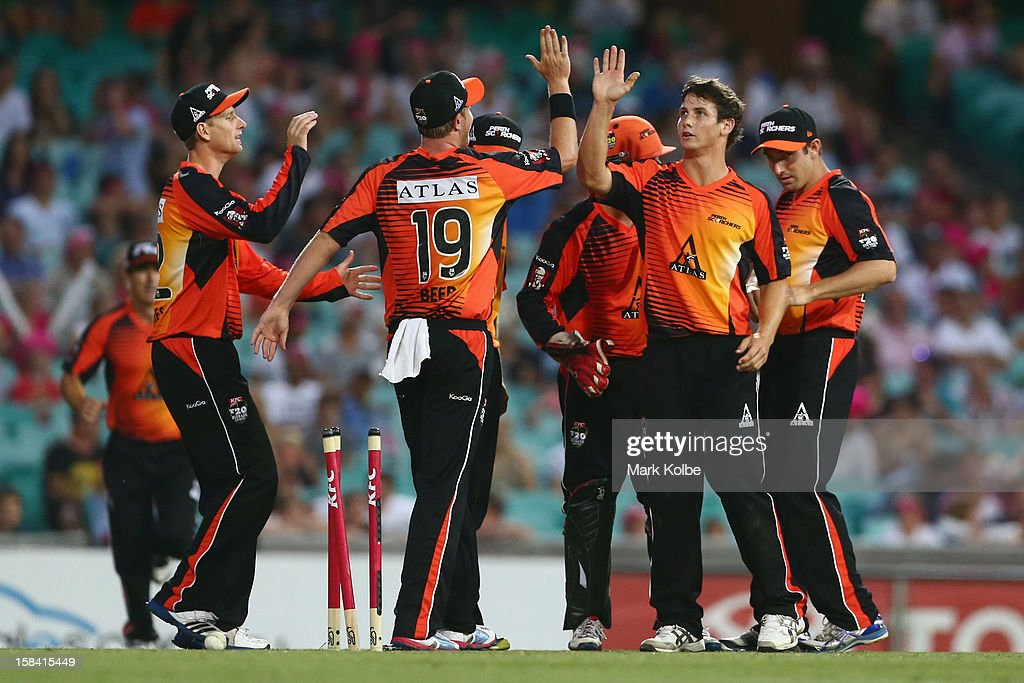 Hilton Cartwright of the Scorchers celebrates with his team mates after taking the wicket of Steve O'Keefe of the Sixers during the Big Bash League match between the Sydney Sixers and the Perth Scorchers at SCG on December 16, 2012 in Sydney, Australia.
