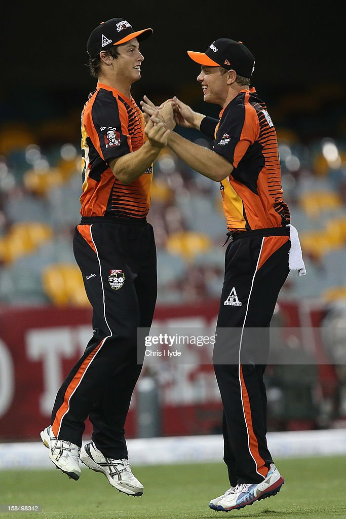 Hilton Cartwright of the Scorchers celebrates with team mates after catching out Luke Pomersbach of the Heat during the Big Bash League match between the Brisbane Heat and the Perth Scorchers at The Gabba on December 18, 2012 in Brisbane, Australia.