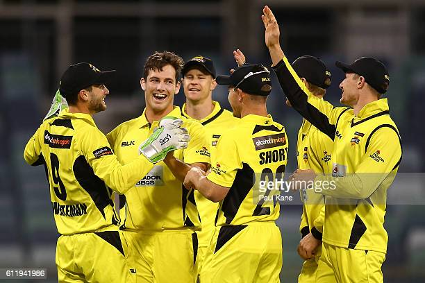 Hilton Cartwright of the Warriors celebrates the wicket of Cameron Valente of the Redbacks during the Matador BBQs One Day Cup match between Western...