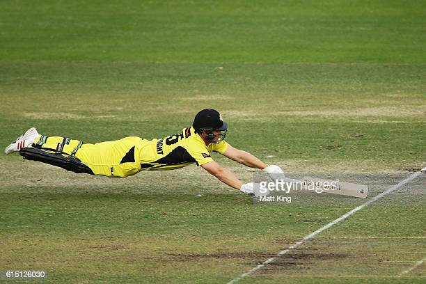 Hilton Cartwright of the Warriors dives in to avoid a runout during the Matador BBQs One Day Cup match between the Cricket Australia XI and Western...