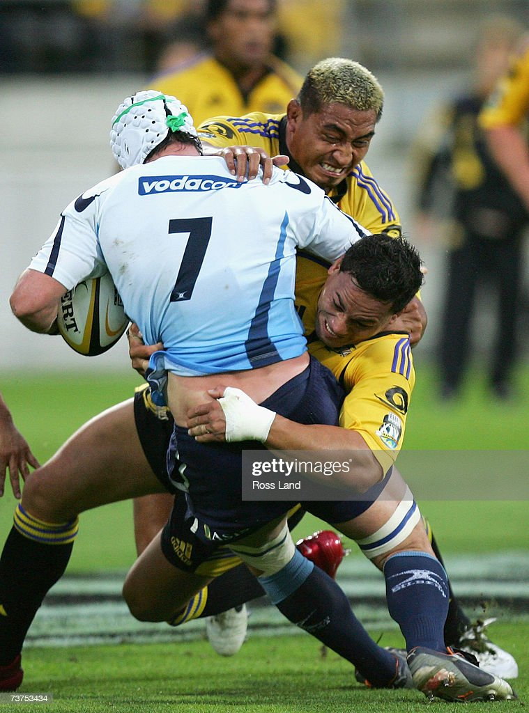 Hilton Lobberts #7 of the Bulls is tackled by Jerry Collins and Chris Masoe of the Hurricanes during the round nine Super 14 match between the Hurricanes and the Bulls at Westpac Stadium March 31, 2007 in Wellington, New Zealand.