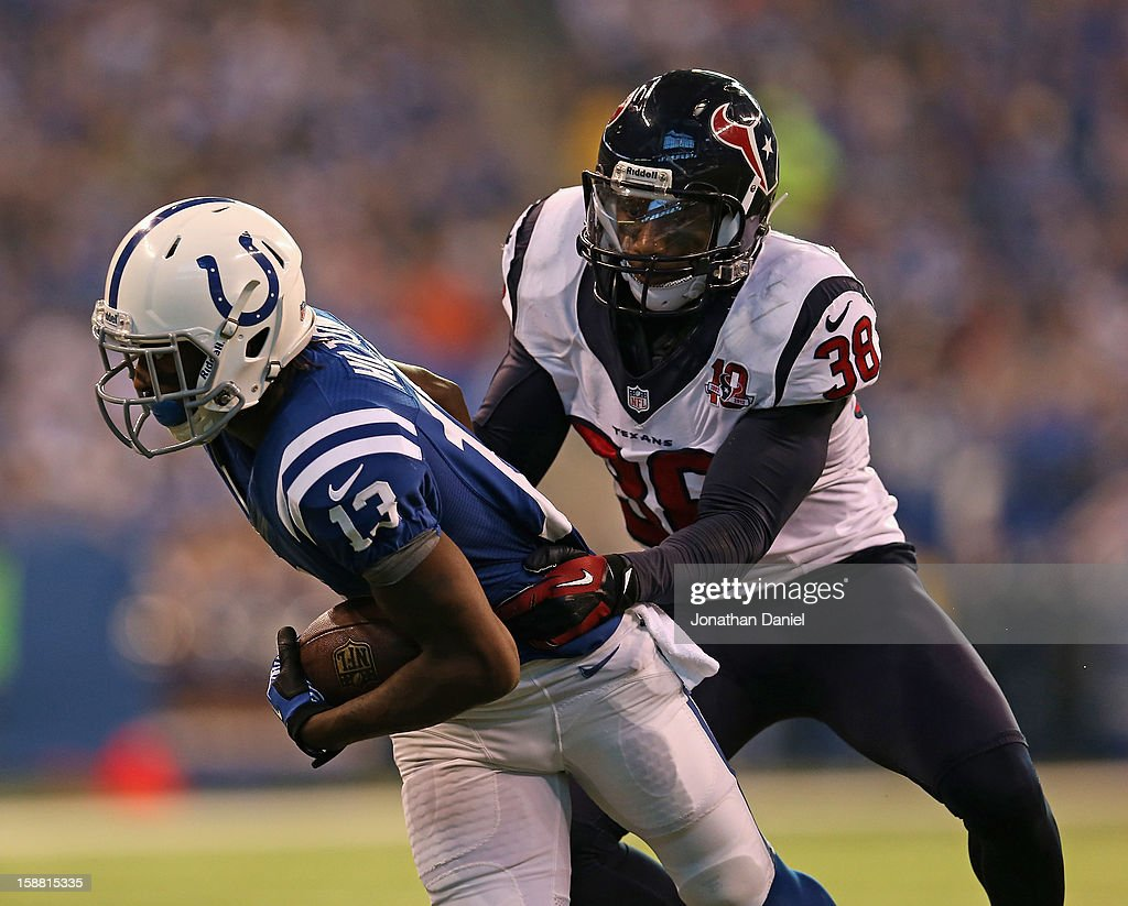 T.Y. Hilton #13 of the Indianapolis Colts breaks away from Danieal Manning #38 of the Houston Texans at Lucas Oil Stadium on December 30, 2012 in Indianapolis, Indiana.