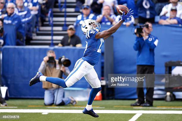 Hilton of the Indianapolis Colts catches a touchdown pass against the New Orleans Saints in the second half of the game at Lucas Oil Stadium on...
