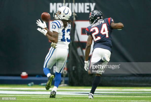 Y Hilton of the Indianapolis Colts catches a touchdown pass defended by Kurtis Drummond of the Houston Texans in the first quarter at NRG Stadium on...