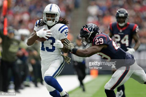 Y Hilton of the Indianapolis Colts is forced out of bounds in the third quarter by Andre Hal of the Houston Texans at NRG Stadium on November 5 2017...