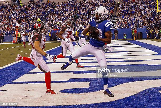 Y Hilton of the Indianapolis Colts makes a touchdown catch in the end zone as Sterling Moore of the Tampa Bay Buccaneers defends at Lucas Oil Stadium...