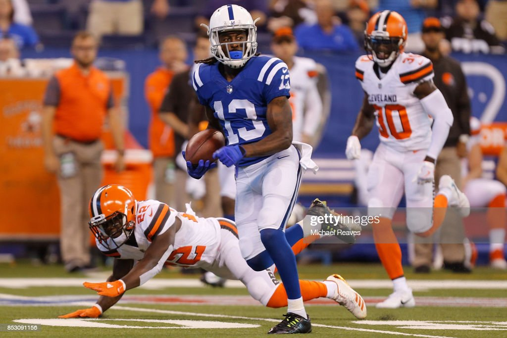 T.Y. Hilton #13 of the Indianapolis Colts runs for a touchdown after a catch against the Cleveland Browns during the first half at Lucas Oil Stadium on September 24, 2017 in Indianapolis, Indiana.