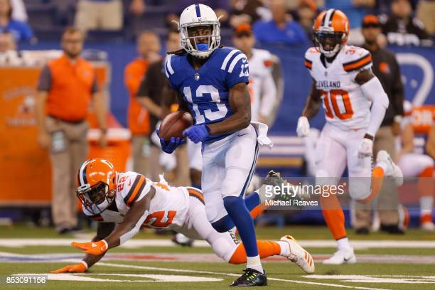 Y Hilton of the Indianapolis Colts runs for a touchdown after a catch against the Cleveland Browns during the first half at Lucas Oil Stadium on...