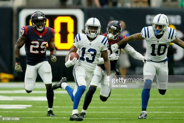 Y Hilton of the Indianapolis Colts runs the ball after a reception defended by Andre Hal of the Houston Texans during the third quarter at NRG...