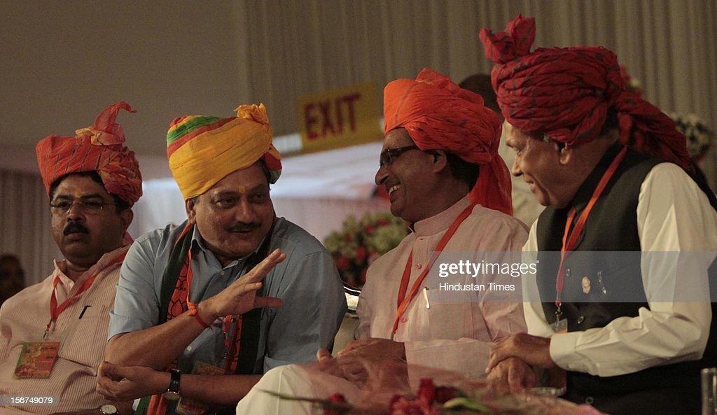 'SURAJKUND, INDIA - SEPTEMBER 27: (R-L) Himachal CM Prem Kumar Dhumal, Madhya Pradesh CM Shivraj Singh Chauhan and Goa CM Manohar Parrikar at the party's National Council meeting at Surajkund on September 27, 2012 in Faridabad, India. (Photo by Sunil Saxena/Hindustan Times via Getty Images)'