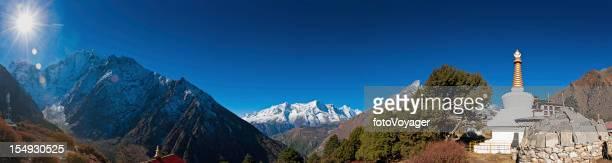 Himalaya sunburst mountain wilderness peaks panorama buddhist stupa Khumbu Nepal