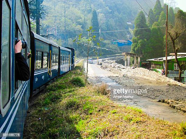 Himalayan toy train passing countryside