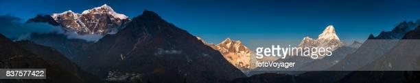 Himalayas alpenglow illuminating snowy mountain peaks Sherpa monastery Khumbu Nepal
