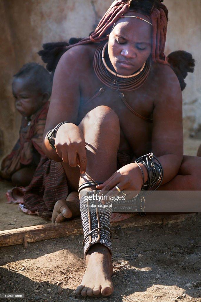 Himba woman by a smoky fire : Stock Photo