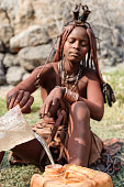 Himba woman collecting water