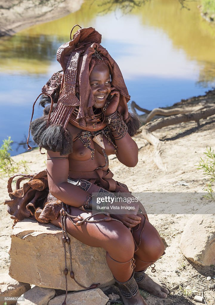 Himba woman with cell phone.