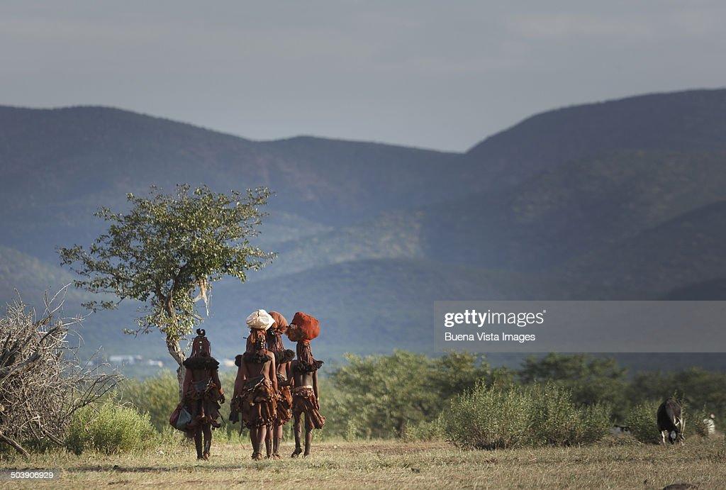Himba women returning to their village