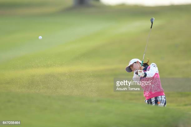 Hina Arakaki of Japan hits from a bunker on the 15th hole during the first round of the Daikin Orchid Ladies Golf Tournament at the Ryukyu Golf Club...