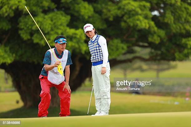 Hina Arakaki of Japan lines up her birdie putt on the 17th green during the third round of the Daikin Orchid Ladies Golf Tournament at the Ryukyu...