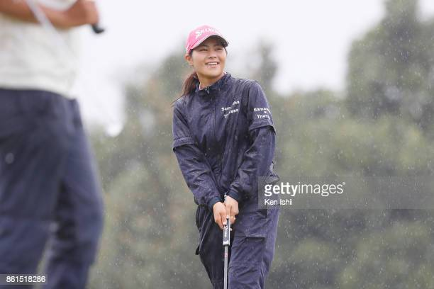 Hina Arakaki of Japan smiles after makes a birdie putt on the 9th hole during the final round of the Udonken Ladies at the Mannou Hills Country Club...