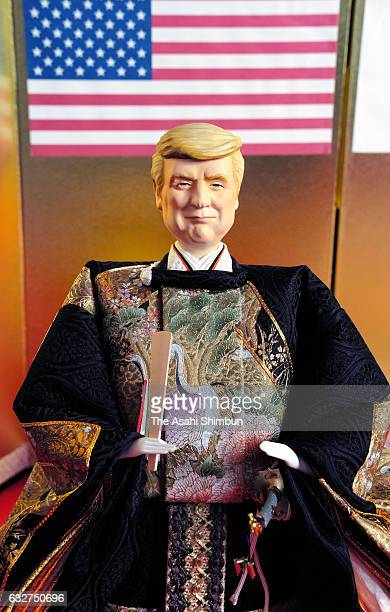 A hina doll depicting US President Donald Trump is on display at doll maker Kyugetsu headquarters on January 26 2017 in Tokyo Japan The hina dolls...