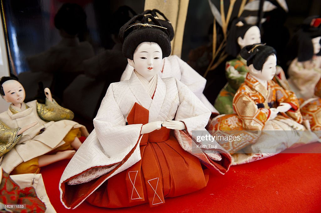Hina Dolls are displayed on February 27, 2013 in Konosu City Hall, Saitama, Japan. The Japanese Doll Festival (Hina Matsuri) or Girls' Day, is held on March 3rd. Platforms covered with red carpet are used to display a set of ornamental dolls representing the Emperor, Empress, attendants, and musicians in traditional court dress of the Heian period.