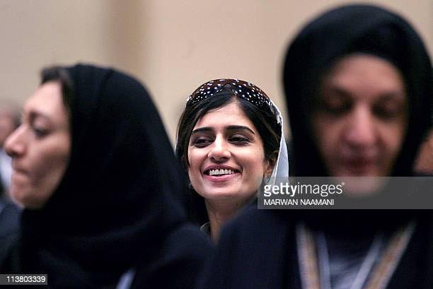 Hina Rabbani Khar a member of the Pakistani Foreign Minister Shukat Aziz delegation flashes a smile as she sits behind Saudi Princesses Noura alSuad...