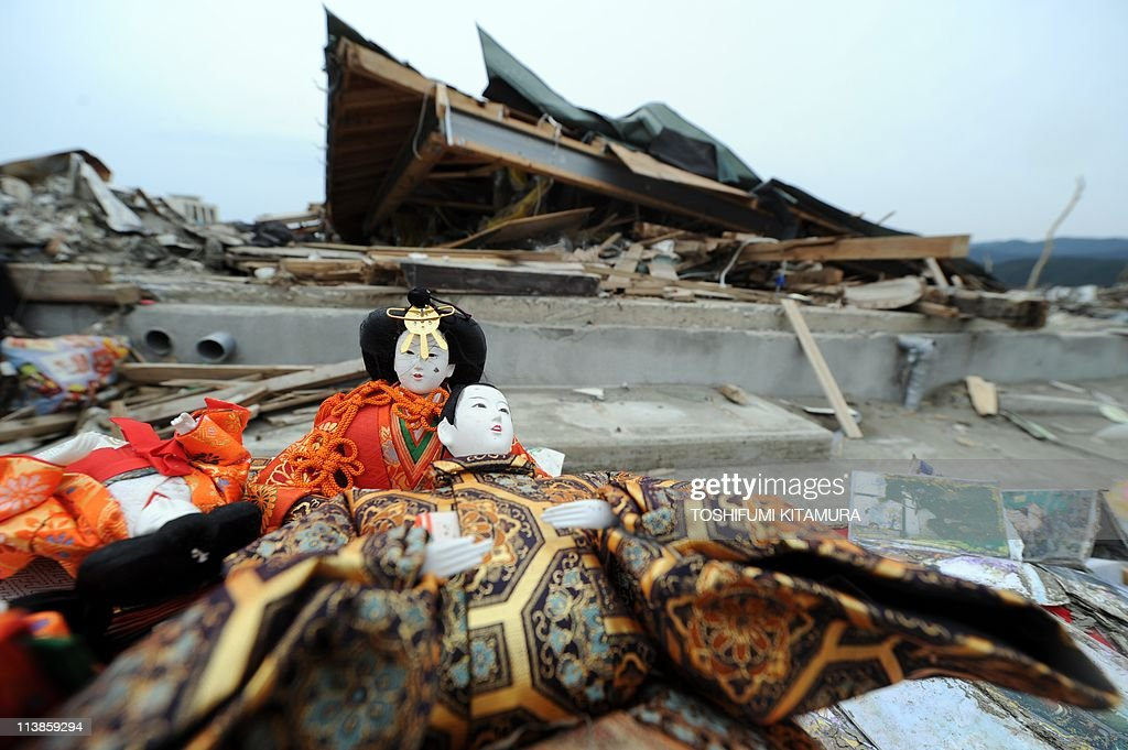 Hinamatsuri dolls traditionally displayed for Girl's Day on March 3 sit beside the road after being salvaged from the debris in the town of...