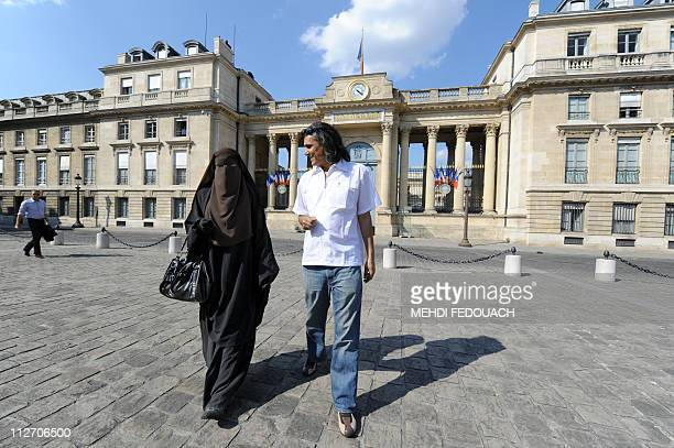 Hind a Niqab veiled woman and real estate magnate Rachid Nekkaz who supports Muslim women fined for wearing the burka or niqab on the street walk in...