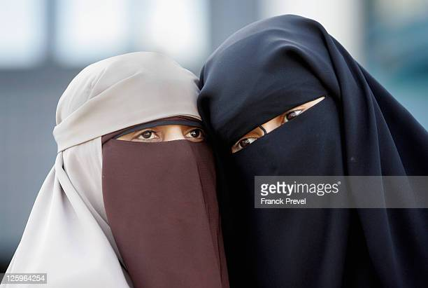 Hind Ahmas stands with Kenza Drider 32 as she leaves the court after being convicted as the first woman wearing a niqab after France's nationwide ban...