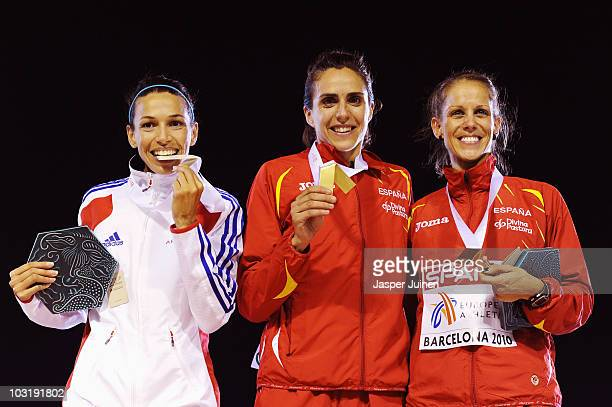 Hind Dehiba of France receives the silver medal Nuria Fernandez of Spain receives the gold medal and Natalia Rodriguez of Spain receives the bronze...