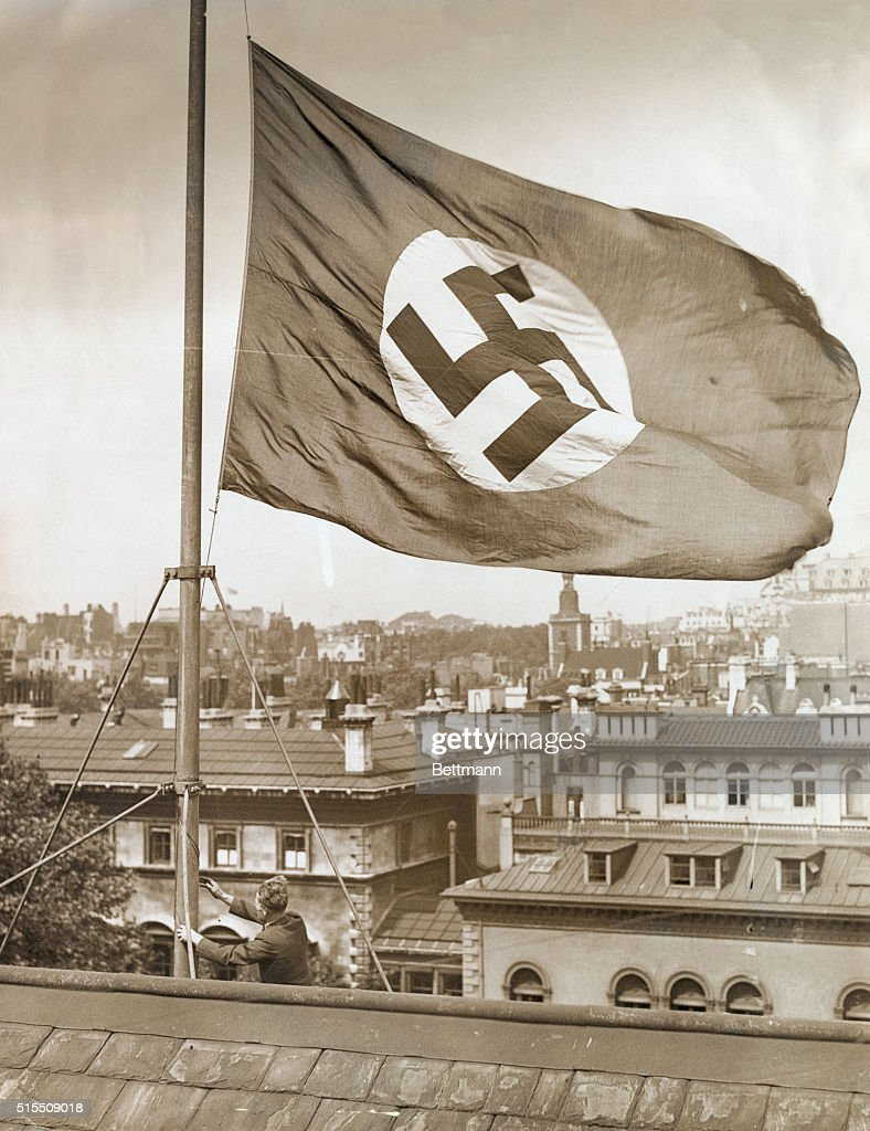 man lowering german flag to half mast pictures getty images
