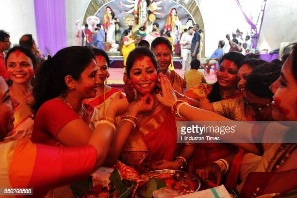 Hindu Bengali women smear sindoor on each other during Sindoor Khela on the final day of the Durga Puja festival on the occasion of Vijayadashami...