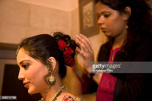 A Hindu bride Shweta Singhal after having been dressed has the finishing touches done to her makeup and hair shortly before the climax of her three...