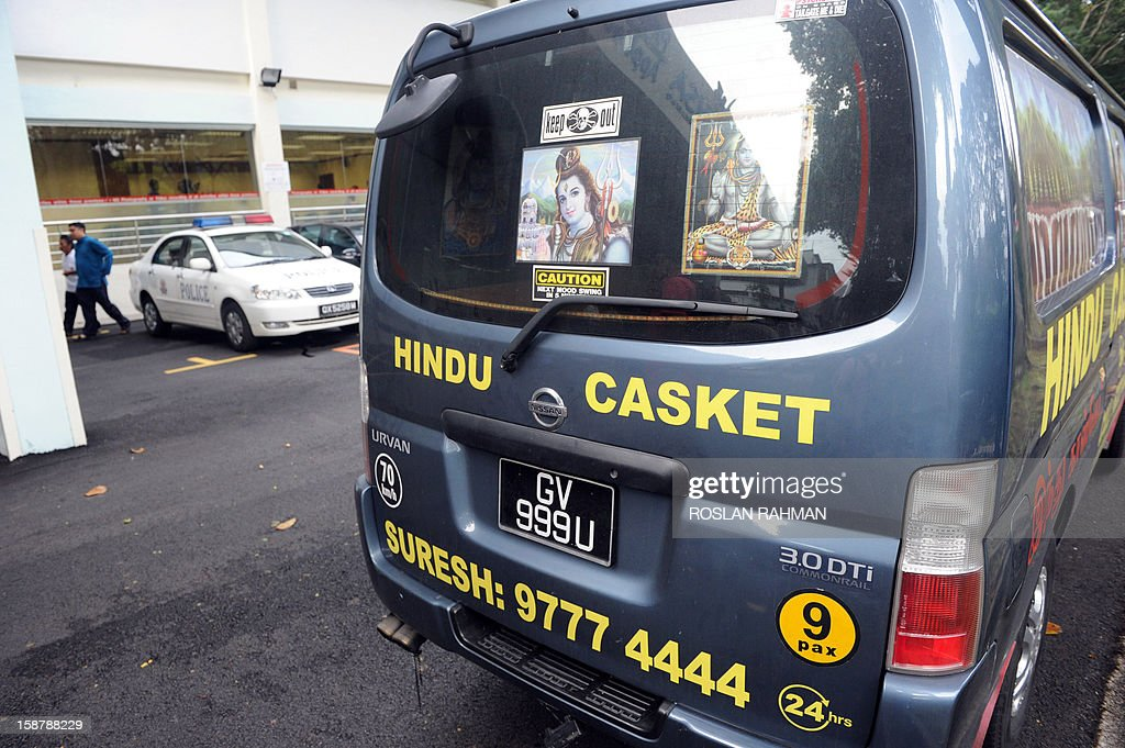 A Hindu casket services van sits parked outside the mortuary building at Singapore General Hospital on December 29, 2012 after an Indian woman whose gang-rape on a bus in New Delhi sparked protests died. The victim, 23, died overnight in Singapore after suffering severe organ failure, the hospital treating her said, in a case that sparked widespread street protests over violence against women. AFP PHOTO / ROSLAN RAHMAN