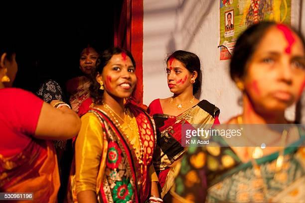 Hindu community women gather to prepare their ritual for Hindu god Bipadtarini Devi in Dhaka Bangladesh July 25 2015 During the ritual of people from...