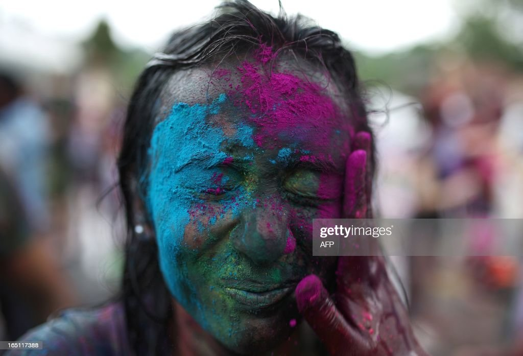 A Hindu covered in coloured powders celebrates 'Holi' at a temple in Kuala Lumpur on March 31, 2013. Holi, the festival of colours where people smear each other with coloured powder and water, is celebrated by Hindus across the country.